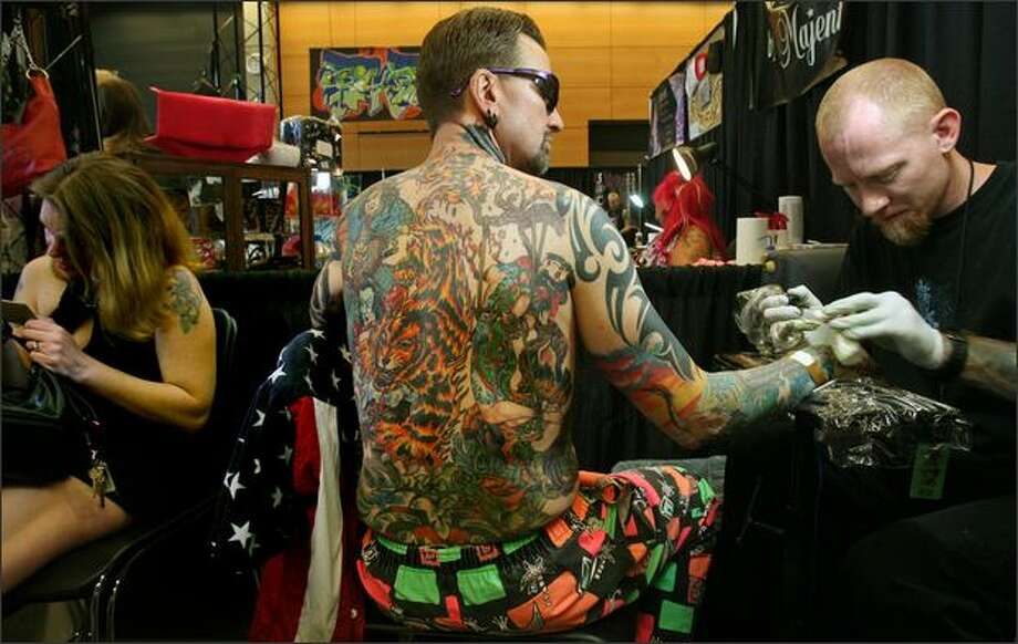 Seattle tattoo expo is equal parts pain beauty for Tattoo expo seattle