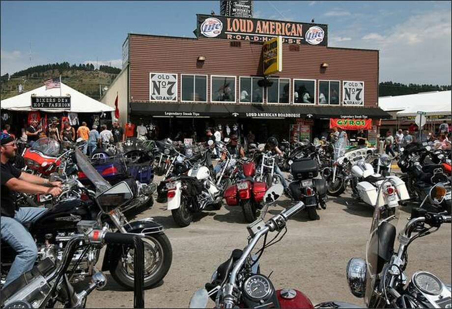 Motorcycle traffic passes by the Loud American Roadhouse in Sturgis, S.D., site of an early-morning shooting. Photo: /Ryan Soderlin/Rapid City Journal