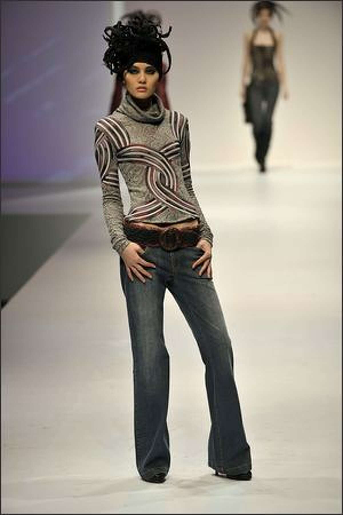 A model showcases designs on the catwalk by Ika on the second day of Hong Kong Fashion Week Autumn/Winter 2008, at Hong Kong Convention & Exhibition Centre (HKCEC) on Tuesday in Hong Kong, China.