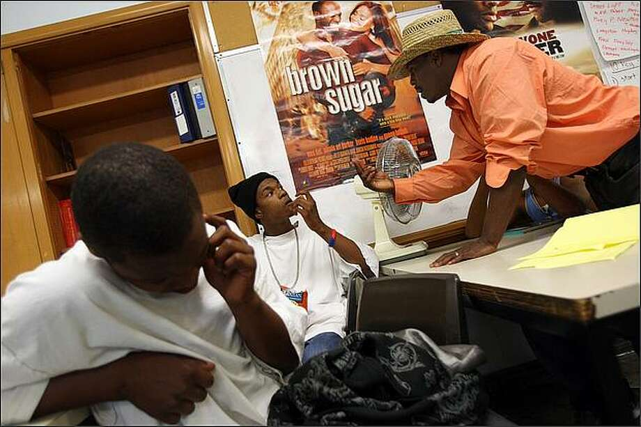 Guest speaker Galen Harper shares his street wisdom with participants of the Youth 180 gang intervention, including Taye Cheatham, center, during a meeting in south Seattle on Wednesday, August 6, 2008. The day before, a youth that Cheatham had grown up with, Pierre Lapoint, 16, was killed in a gang-related shooting, and Youth 180 staffers were concerned about Cheatham's reaction. Photo: Mike Kane/Seattle Post-Intelligencer