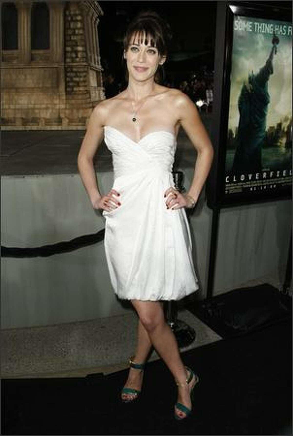 Actress Lizzy Caplan arrives.