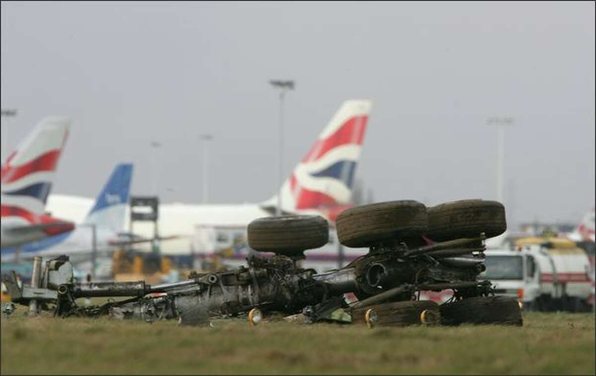 The wheels of a British Airways plane are seen on Terminal 4 of Heathrow Airport in London.