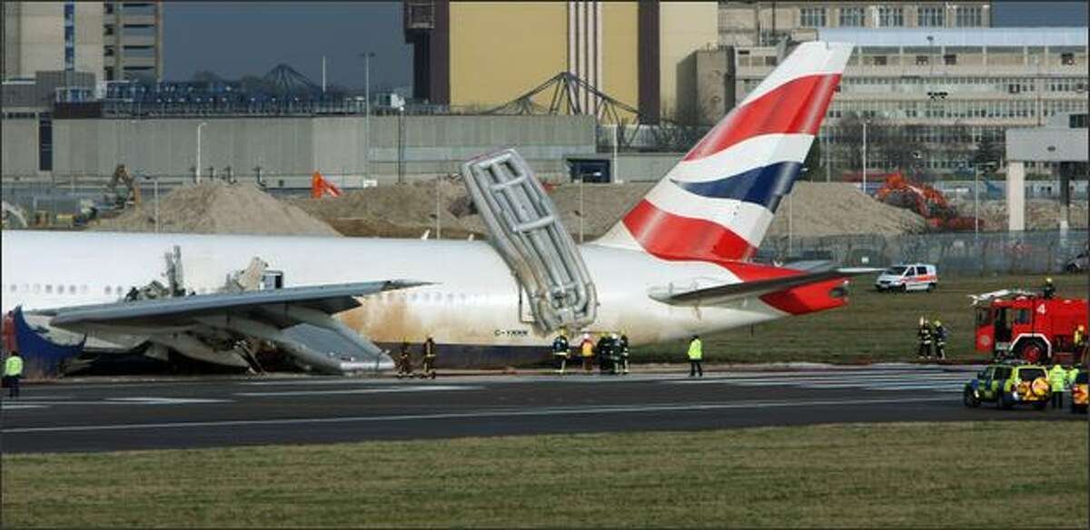 Emergency services surround a British Airways plane on Terminal 4 of Heathrow Airport in London, England.