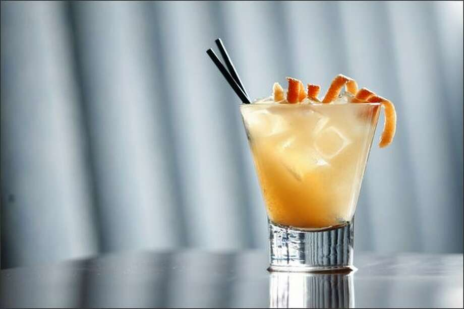 Venik Lounge's delish Gray Sky gets its pucker power from fresh-squeezed pink grapefruit juice with the vodka melting into the background. Photo: Andy Rogers/Seattle Post-Intelligencer