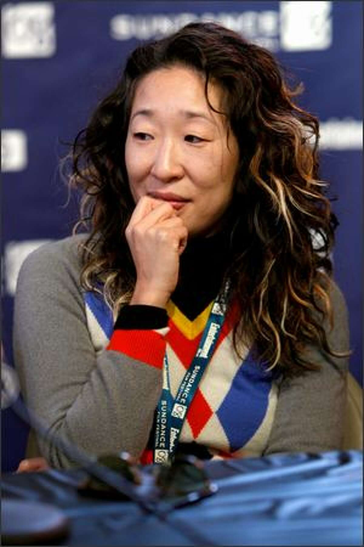 Dramatic competition juror, actress Sandra Oh, speaks at the jurors' press conference held at the Sundance House during the 2008 Sundance Film Festival in Park City, Utah.