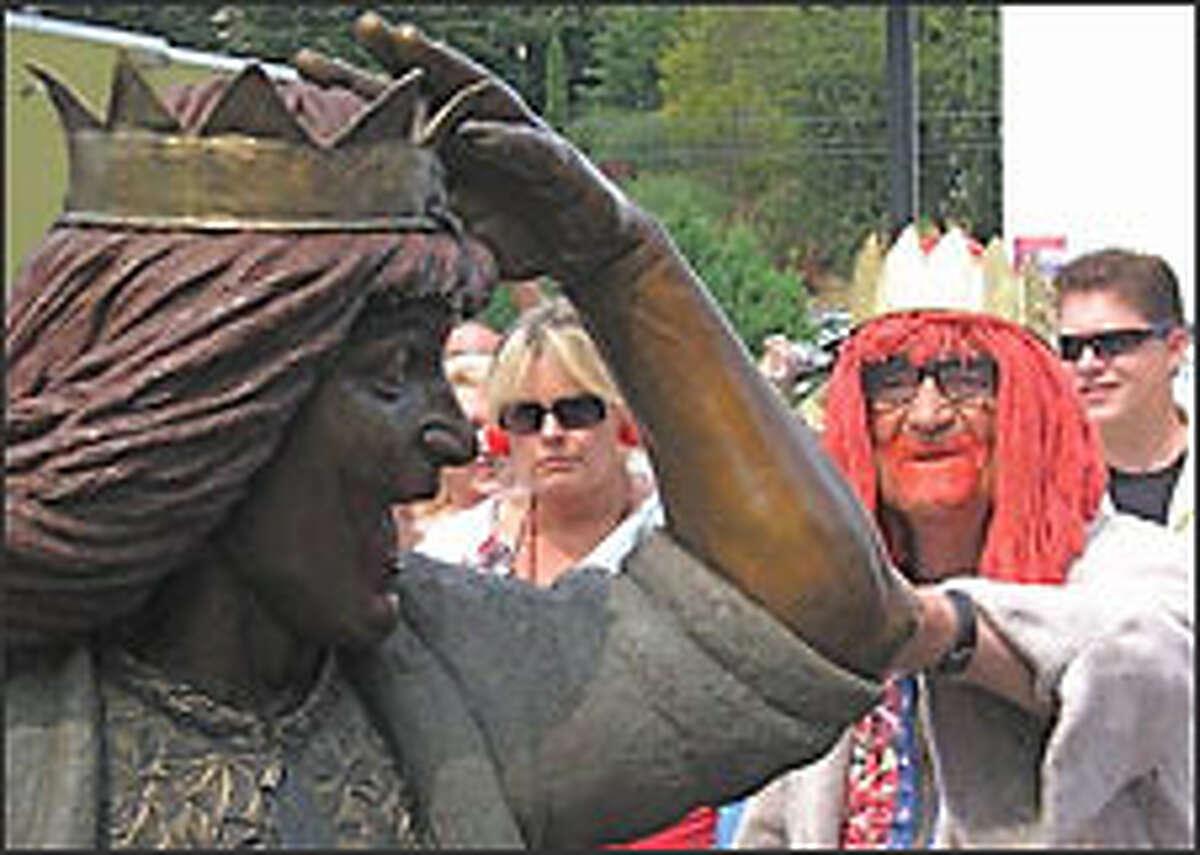 J.P.'s longtime sidekick Bob Newman, background, examines the Gertrude statue.