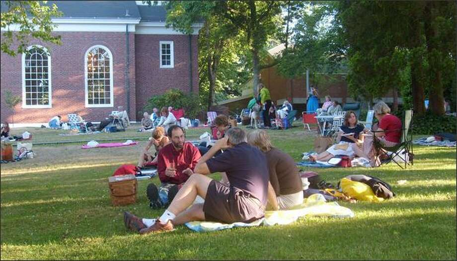 The spacious lawn outside St. Nicholas Hall on the campus of Lakeside School has been is a big draw for the Seattle Chamber Music Festival. Photo: / Gerald Hedman