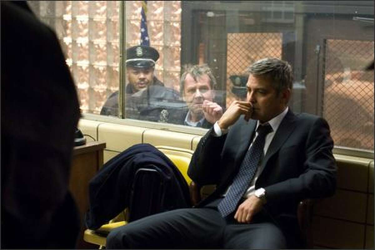 Tom Wilkinson (center) as Arthur Edens and George Clooney as Michael Clayton star in