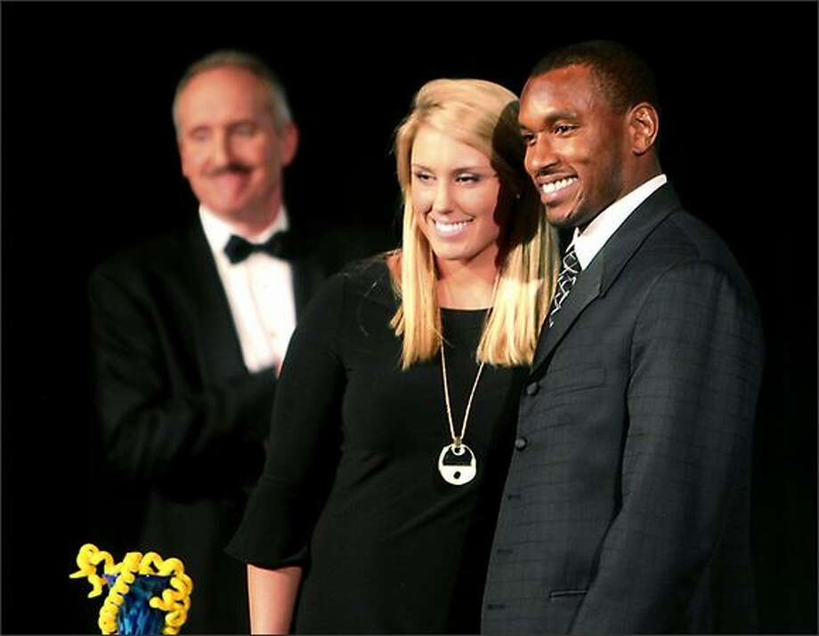 P-I Sports Stars of the Year Dannielle Lawrie, center, and Bobby Engram, pose for the cameras as emcee Steve Raible looks on in the background. Photo: Scott Eklund, Seattle Post-Intelligencer