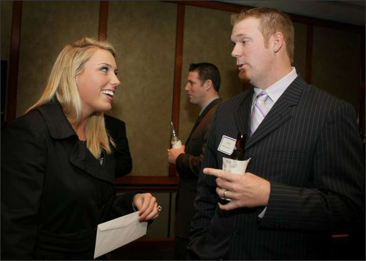 UW softball pitcher Danielle Lawrie and Mariners closer J.J. Putz chat in the VIP room at the P-I Sports Star of the Year banquet at The Westin Seattle.