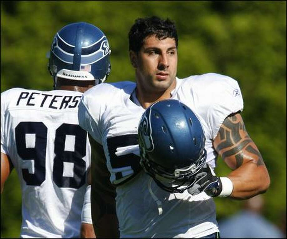 Jason Babin, right, acquired last year from the Texans, is in a spirited battle for the Seahawks' fourth and perhaps final defensive end spot. Photo: Andy Rogers/Seattle Post-Intelligencer