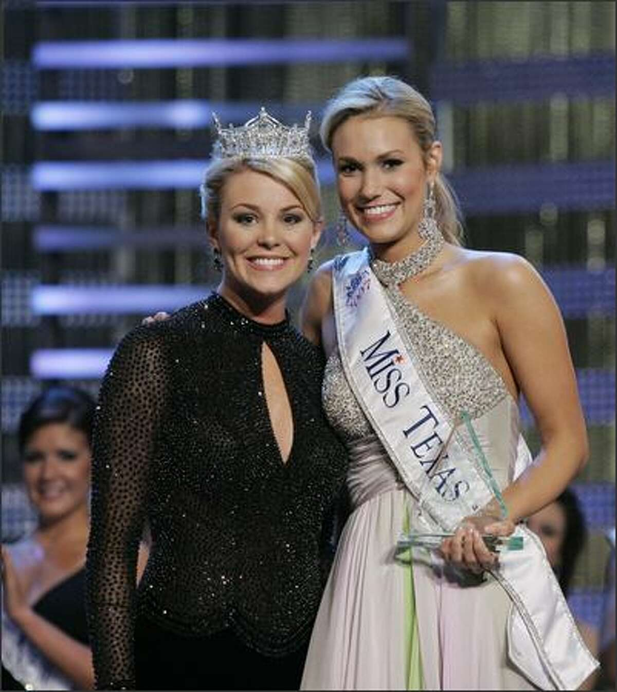 Miss Texas Molly Hazlett (right) receives her award from Miss America 2007 Lauren Nelson.
