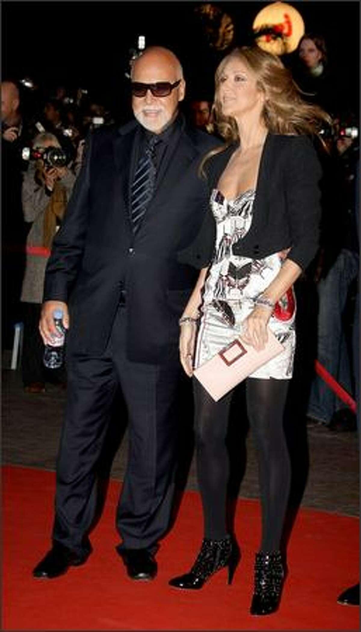 Singer Celine Dion and husband Rene Angelil attend.