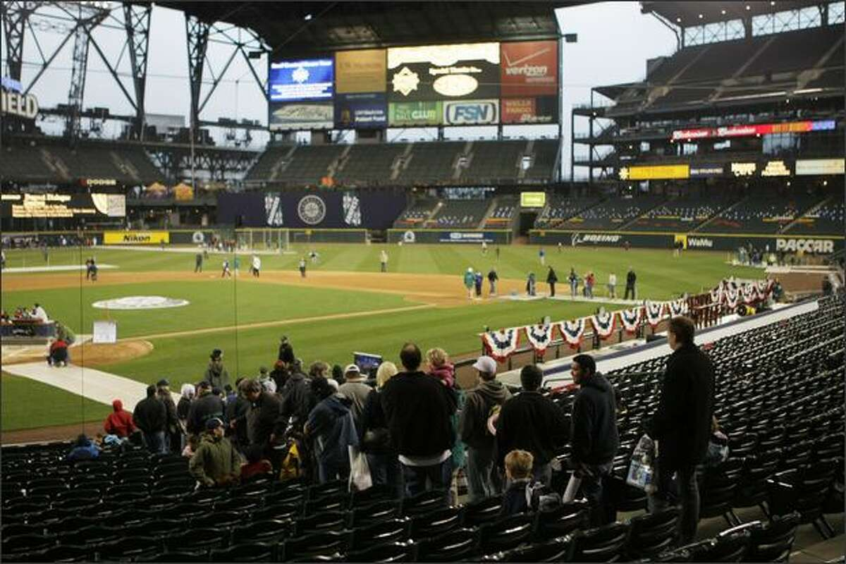 Mariners fans line up to get onto the field during the 10th annual Mariners FanFest at Safeco Field in Seattle.