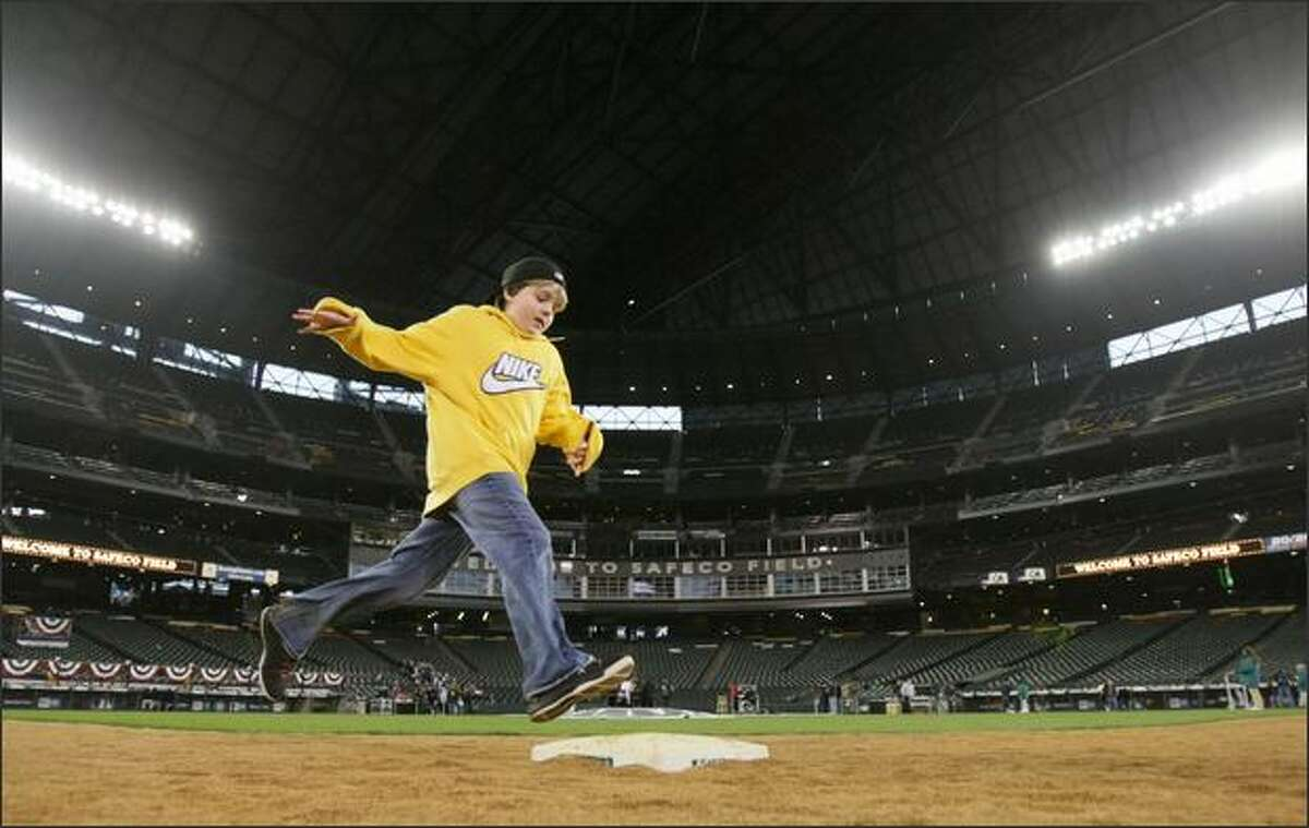 Austin Heitzinger, 13, of Seattle, rounds second base at Safeco Field.