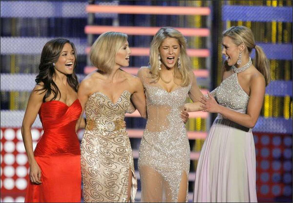 Miss Michigan Kirsten Haglund, second from right, reacts as she is named Miss America 2008 during the Miss America Pageant at the Planet Hollywood hotel and casino in Las Vegas. (AP Photo/Jae C. Hong)