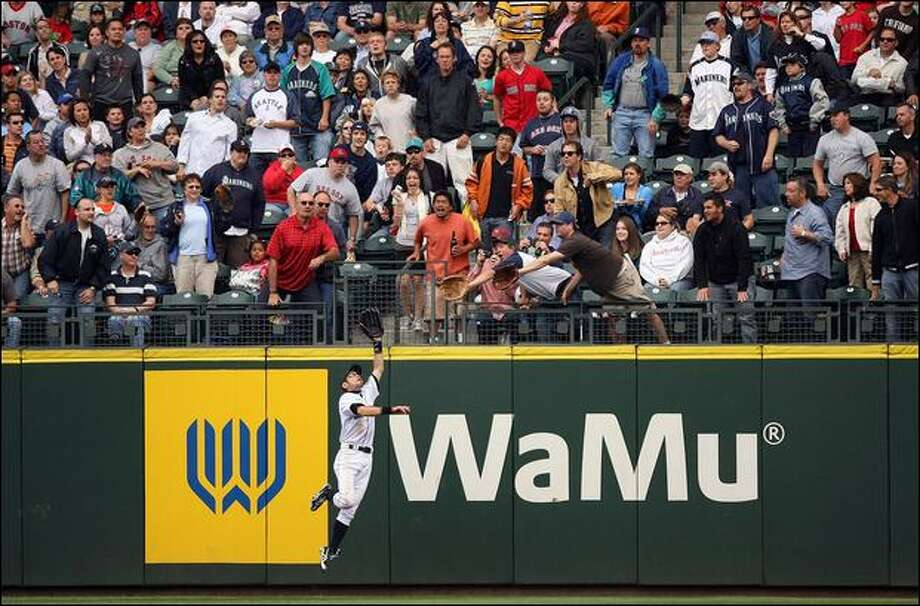 Fans at Safeco Field watch Ichiro Suzuki soar to catch the ball at the wall against Boston on July 23. Photo: Otto Greule Jr./Getty Images