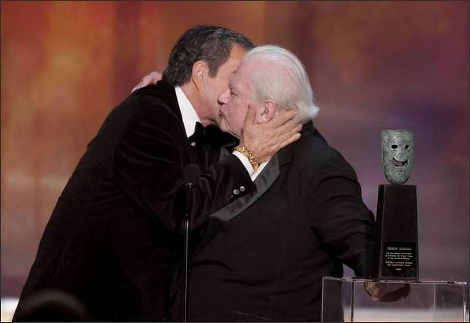 Burt Reynolds, left, kisses Charles Durning, recipient of the 2007 Actors Guild Life Achievement Award, during the 14th annual Screen Actors Guild Awards. Photo: Getty Images