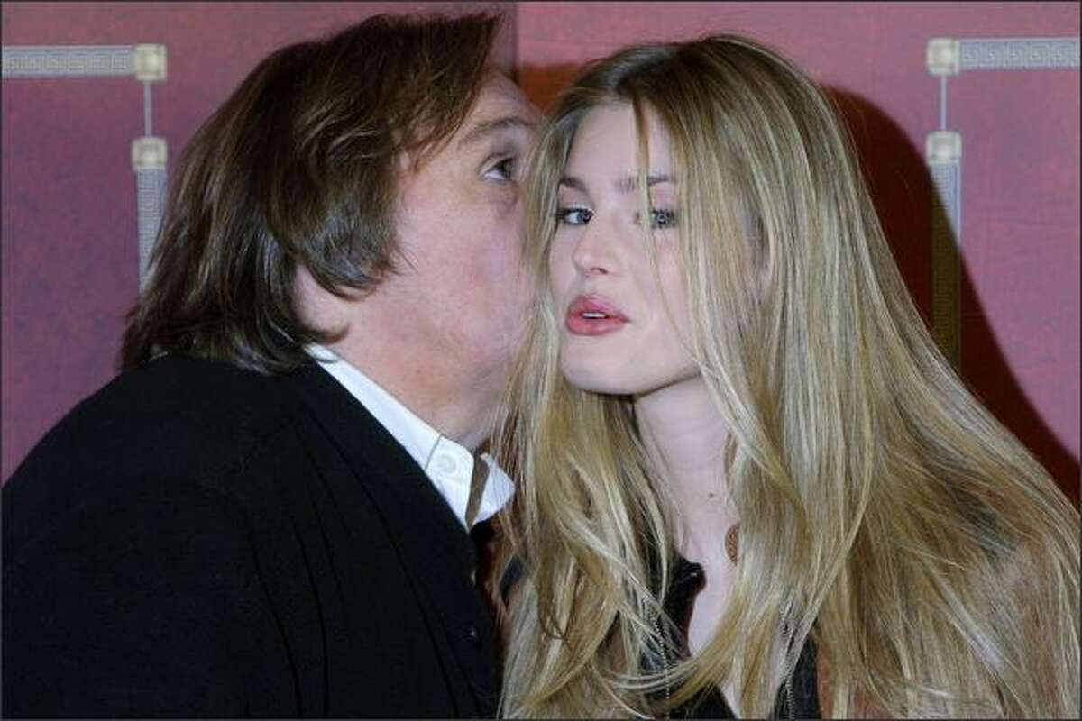 Actors Gerard Depardieu and Vanessa Hessler attend the 'Asterix at the Olympic Games' Italian Photocall at the St. Regis Hotel, Monday, in Rome, Italy.