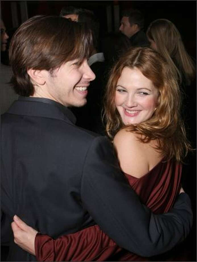 "Actor Justin Long and actress Drew Barrymore arrive at Picture House's premiere of ""Vince Vaughn's Wild West Comedy Show"" in Hollywood, California. Photo: Getty Images"