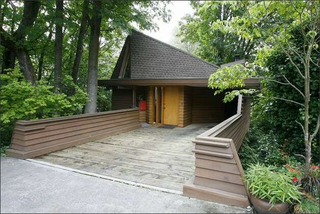 The Strickers' three-level house appears cottage-size from the street. From inside, you see trees but no other houses. Photo: Gilbert W. Arias/Seattle Post-Intelligencer