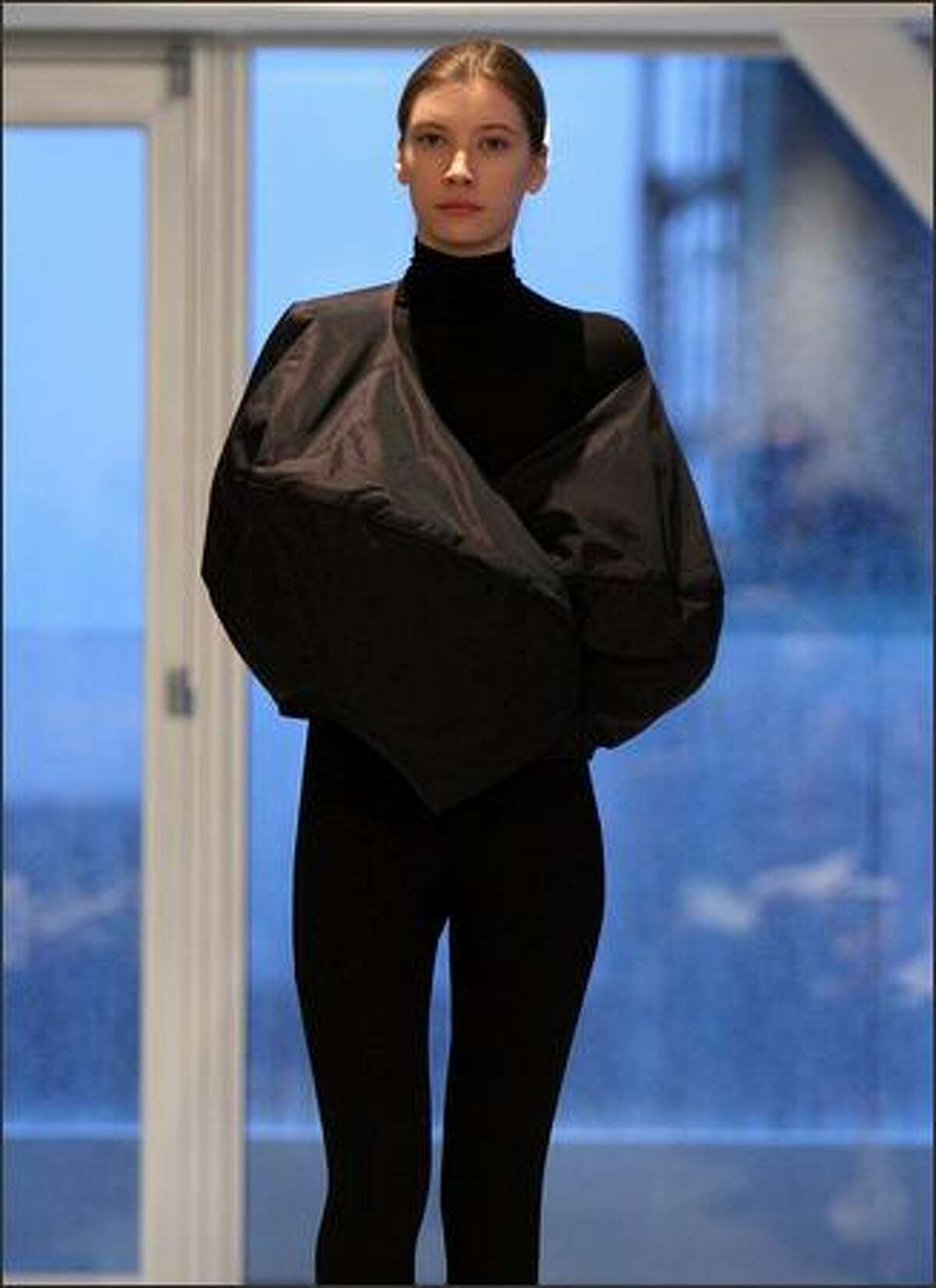 A model displays a creation by Yeohlee.