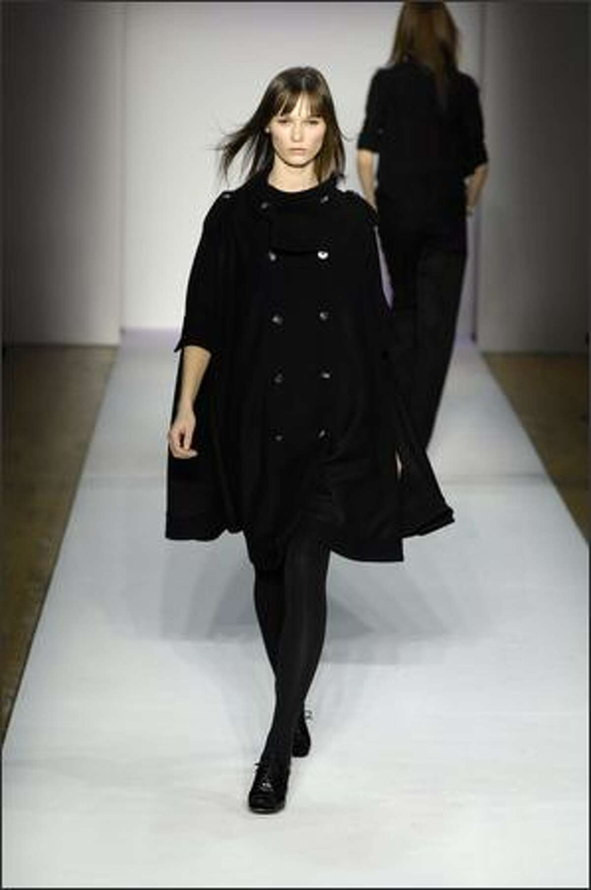 A model walks the runway at the Na-be By Victorya Hong fall 2008 fashion show during Mercedes-Benz Fashion Week at The Altman Building in New York. Ms. Hong was a contestant on the current version of the hit TV series