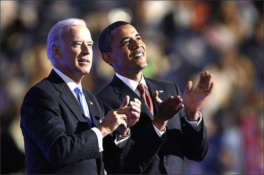 Sen. Barack Obama and his vice presidential candidate, Sen. Joe Biden, are seen at the Democratic National Convention in Denver on Wednesday night. (AP Photo/Paul Sancya) Photo: / Associated Press