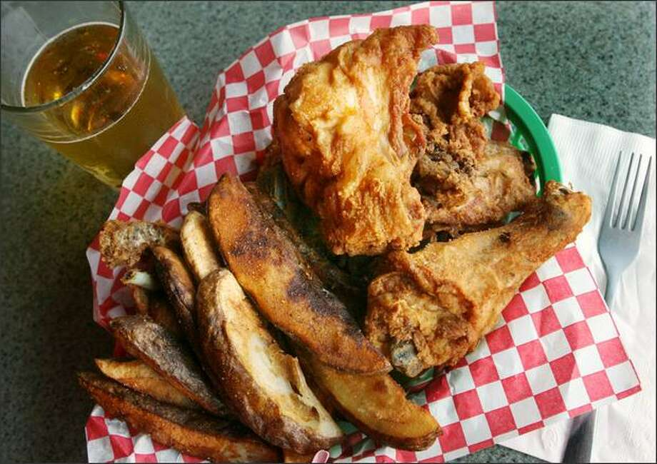 "Five pieces of ""pressure-fried chicken"" and jo-jos cost $9.95. The beer is extra, but, as we all know, a necessity. Photo: Dan DeLong/Seattle Post-Intelligencer"