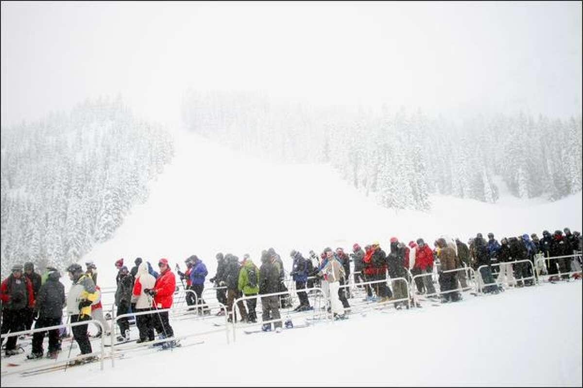Skiers line up for the Rainer Express chair lift at Crystal Mountain near Enumclaw on Saturday.