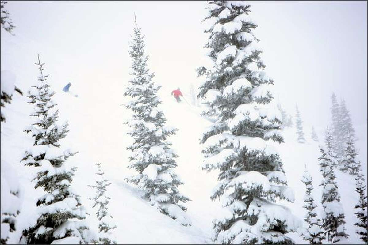 Skiers enjoy epic snow conditions at Crystal Mountain.