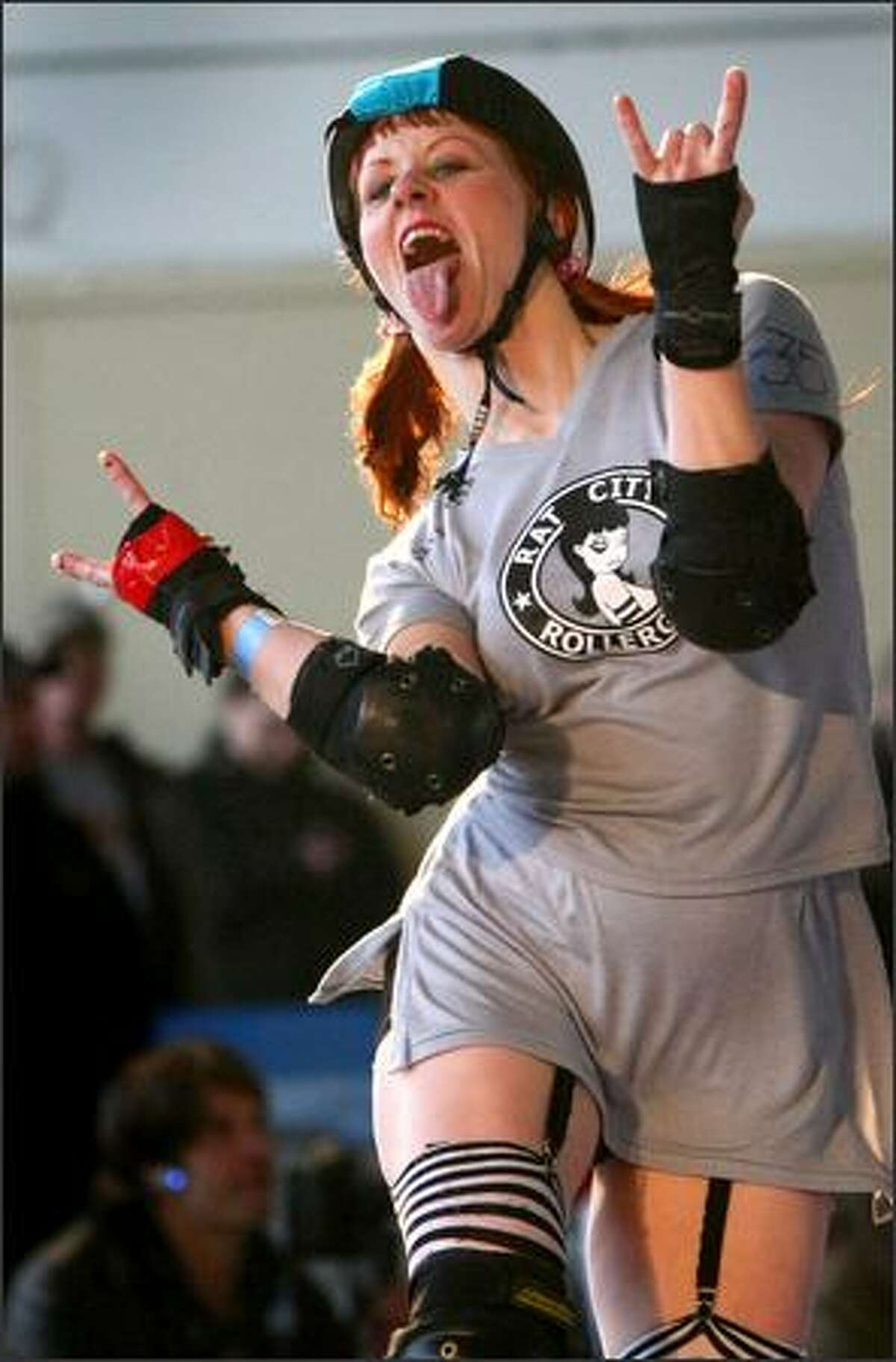 """""""mommacherry"""" has fun as she is sent to the penalty box during a match against Treasure Valley of Boise, Idaho, during the Seattle Rust Riot roller derby tournament at Magnuson Park in Seattle. The all-day, single-elimination event featured the Rat City Rollergirls' Rain of Terror from Seattle, the Jet City Rollergirls from Everett, the Lava City Roller Dolls from Bend, Ore., the Lilac City Rollergirls from Spokane, the Oly Rollers from Olympia, the Rose City Rollers from Portland, the Slaughter County Roller Vixens from Bremerton and the Treasure Valley Rollergirls from Boise, Idaho."""