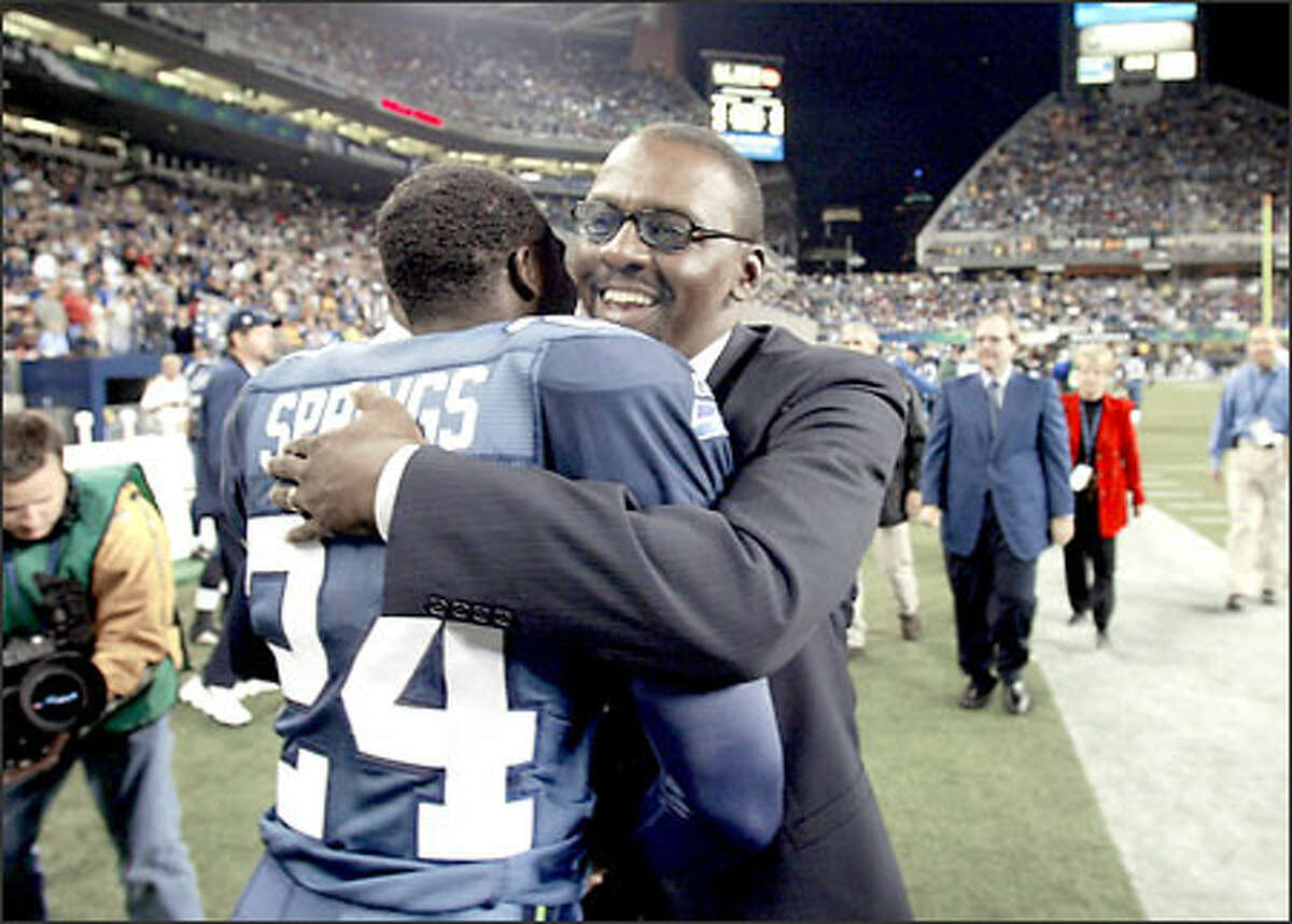 Kenny Easley and Seahawks cornerback Shawn Springs embrace after Easley became the seventh former Seahawks player selected to the team's Ring of Honor.