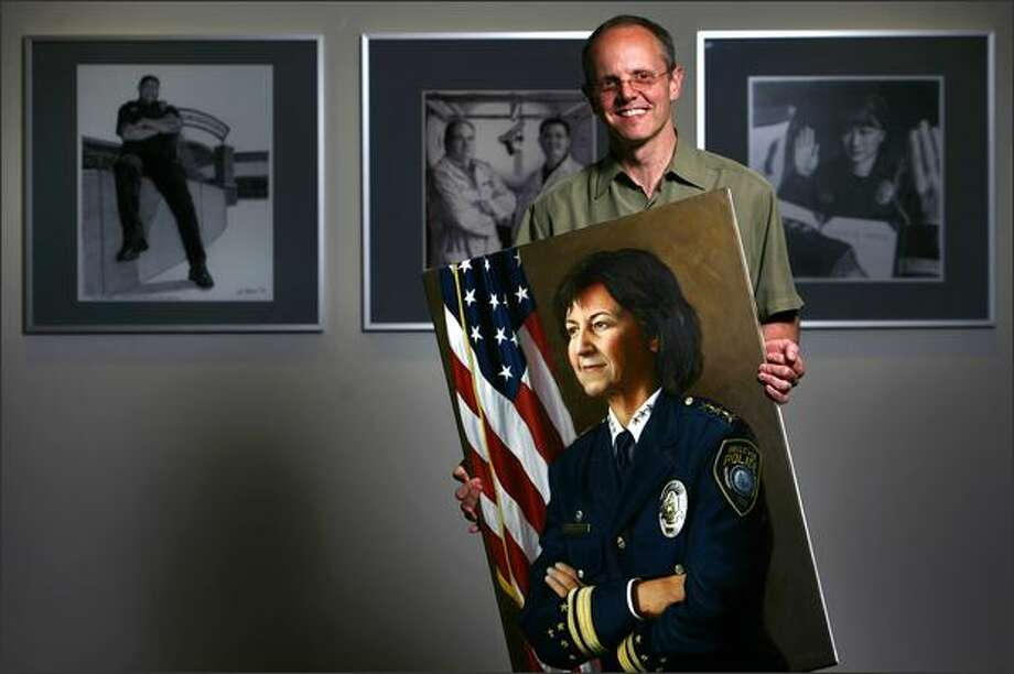 Bellevue Police Detective Greg Bean shows his oil portrait of the department's chief, Linda Pillo. Photo: Joshua Trujillo/Seattle Post-Intelligencer