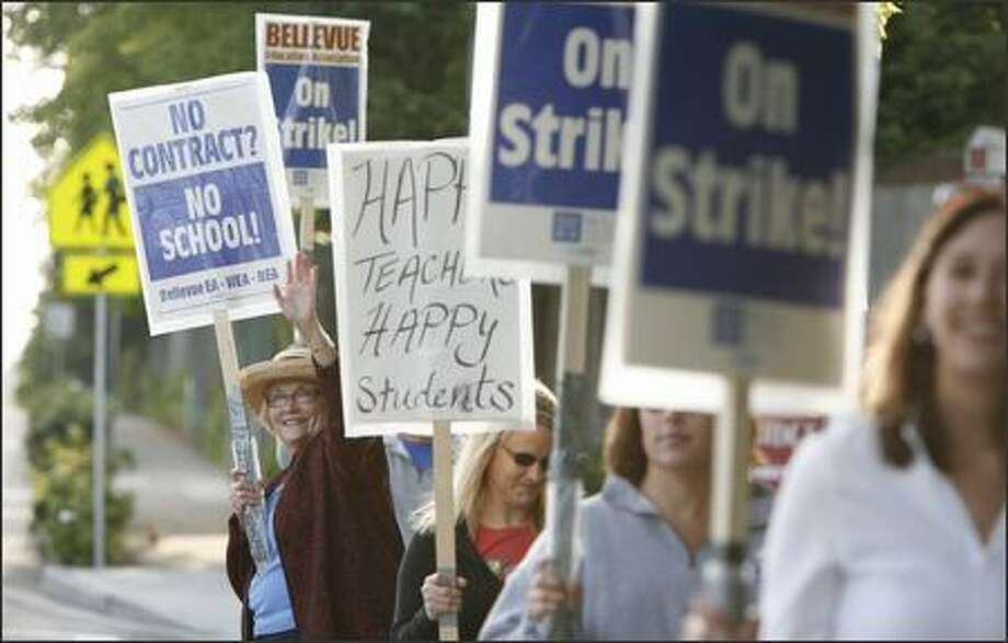 Linda Casey, an art teacher at Odle Middle School in Bellevue, and dozens of her colleagues picketing on Tuesday. Casey has taught in the Bellevue School District for six years. Photo: Paul Joseph Brown/Seattle Post-Intelligencer