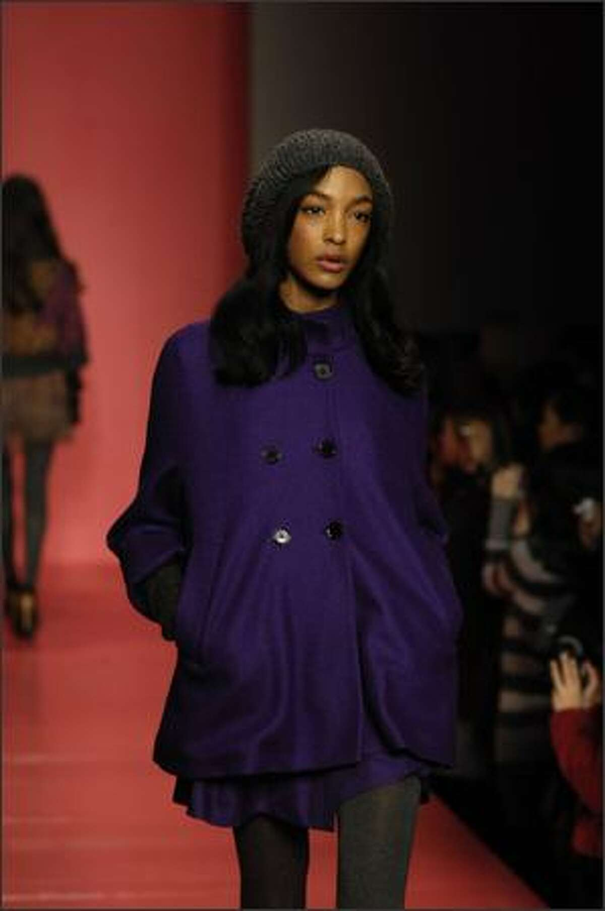 A model walks the runway at the DKNY Fall 2008 fashion show during Mercedes-Benz Fashion Week Fall 2008 on February 3, 2008 in New York City.