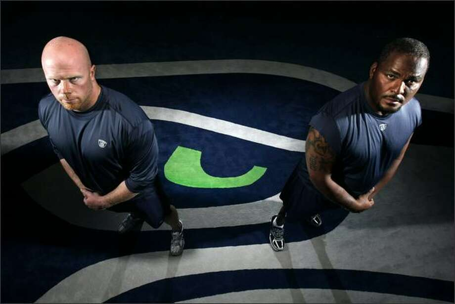 Guard Mike Wahle, left, joins tackle Walter Jones to give the Seahawks an imposing left side of the line. The Seahawks rebuilt their running game after struggling to convert third downs in 2007. Photo: Andy Rogers/Seattle Post-Intelligencer