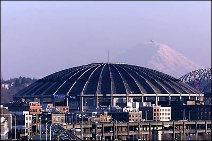 From Victor Steinbrueck Park at the Pike Place Market, the view includes a glimpse of Mount Rainier.
