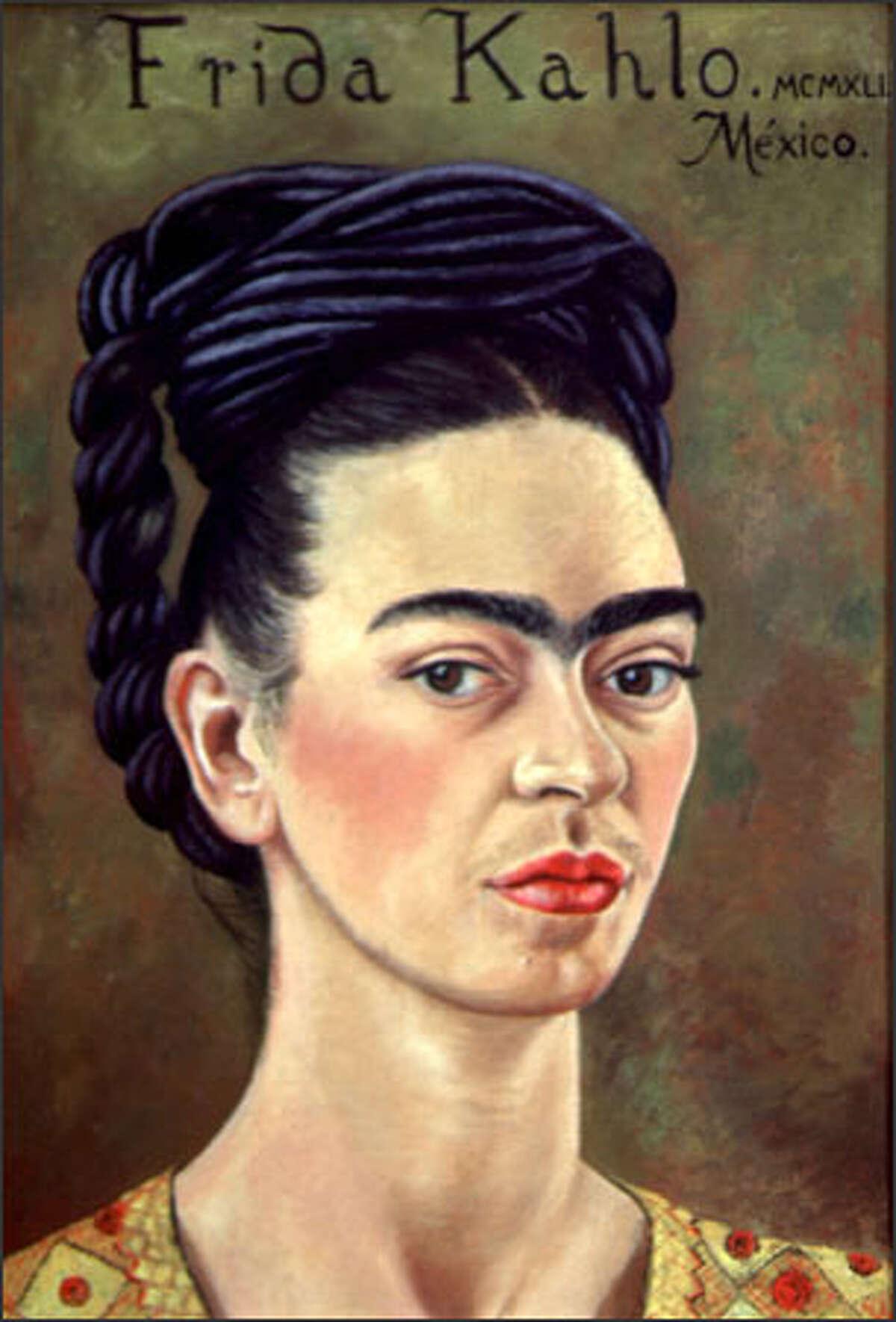 """Self-Portrait with Red and Gold Dress"" (""Autorretrato con Vestido Rojo y Dorado""), 1941. Oil on canvas, 39 x 27.5 cm. Courtesy of the Vergel Foundation, New York. © 2002 Banco de Mexico, Diego Rivera & Frida Kahlo Museum Trust."