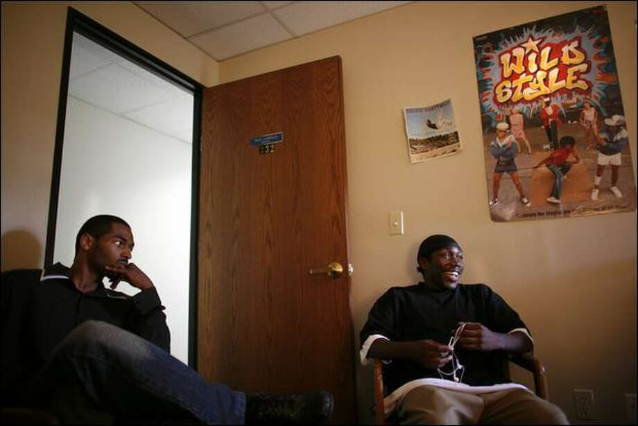 Jont Ausler, 26, left, and Carlos Bernardez, 18, meet with a social worker for Raising Our Youth As Leaders in Seattle last Friday. ROYAL is a project where mentors help young people. Photo: Joshua Trujillo/Seattle Post-Intelligencer