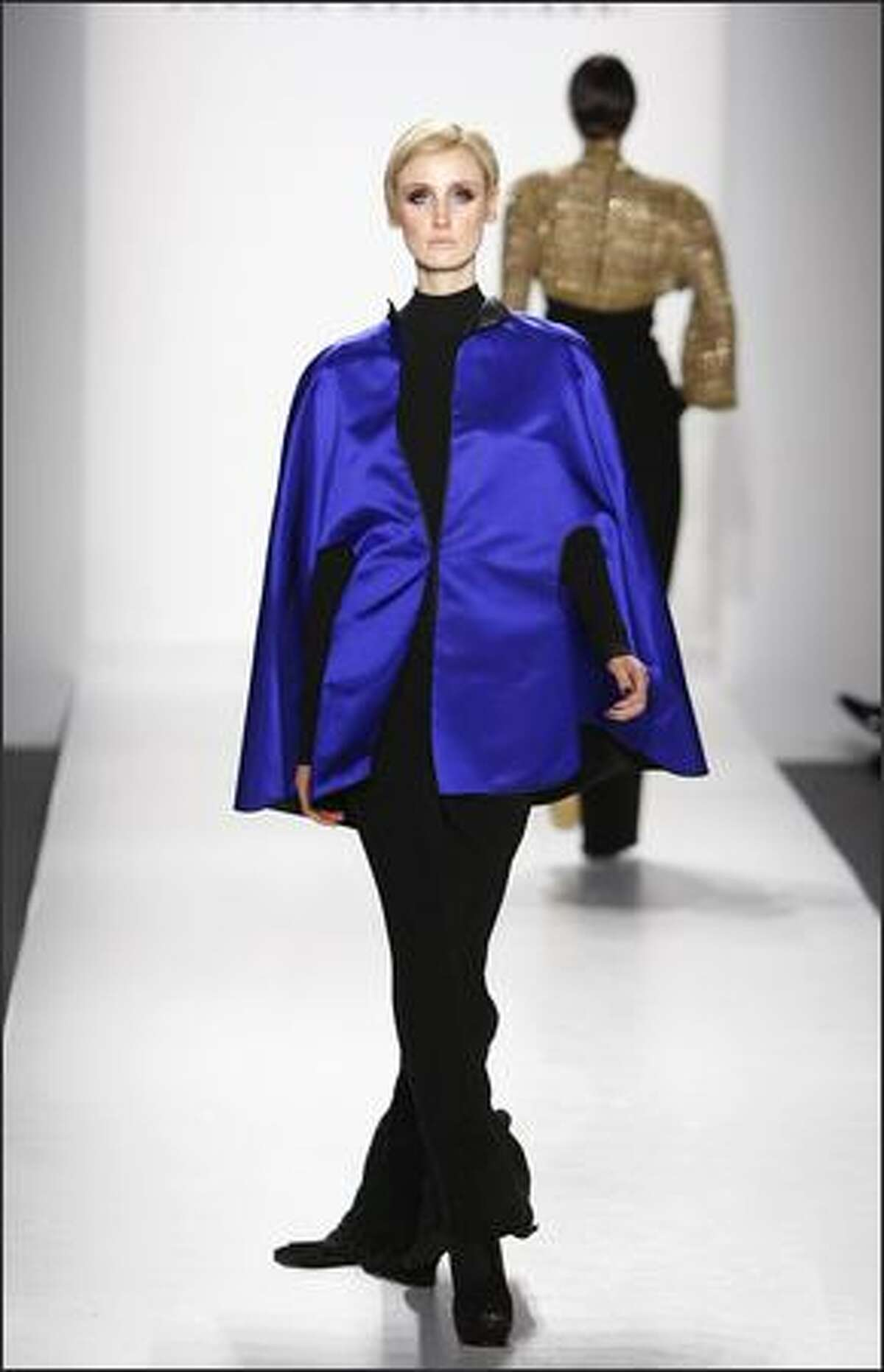 A model walks the runway at the Joanna Mastroianni fall 2008 fashion show during Mercedes-Benz Fashion Week at The Salon at Bryant Park in New York.