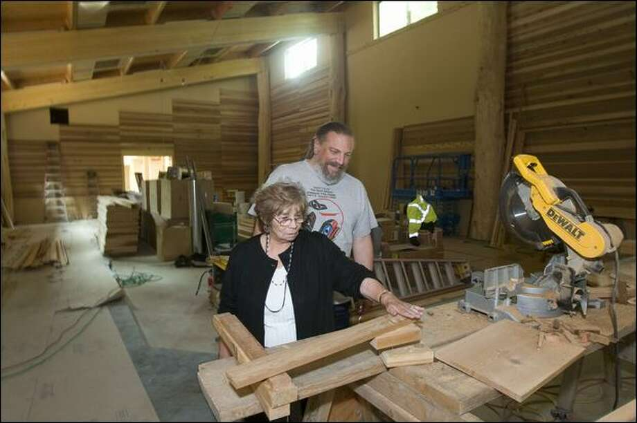 Cecile Hansen, Duwamish Tribal chairwoman, and James Rasmussen, a tribal council member, give a tour of a longhouse the tribe is completing on West Marginal Way South. Photo: Grant M. Haller/Seattle Post-Intelligencer