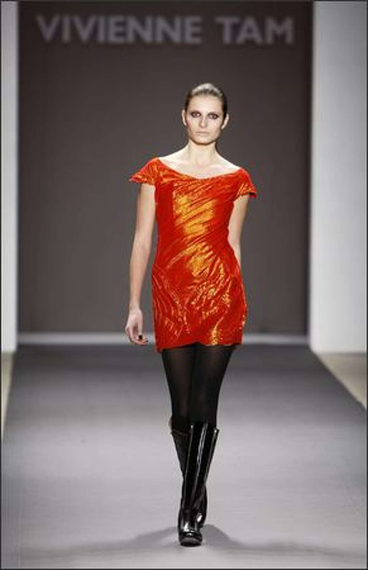 A model displays a creation by Vivienne Tam.