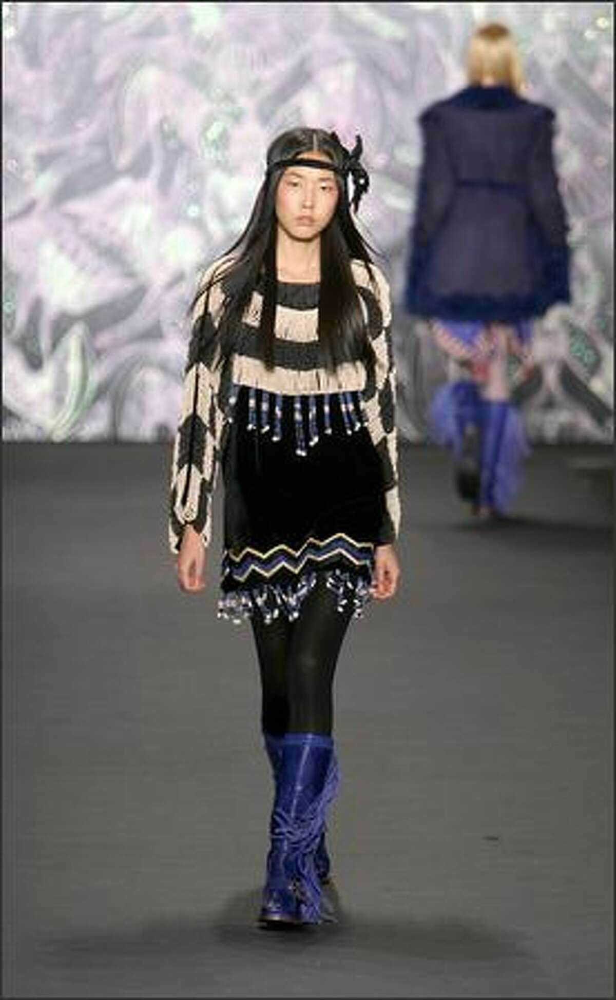 A model displays a creation by Anna Sui.