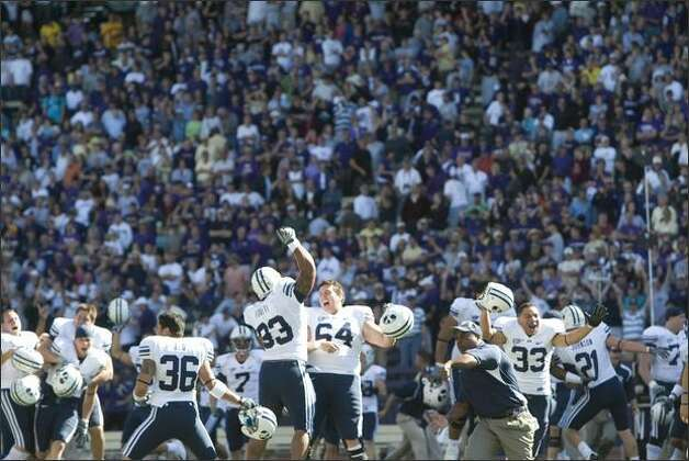 BYU players celebrate in front of Husky fans after winning the game 28-27. Photo: Grant M. Haller/Seattle Post-Intelligencer