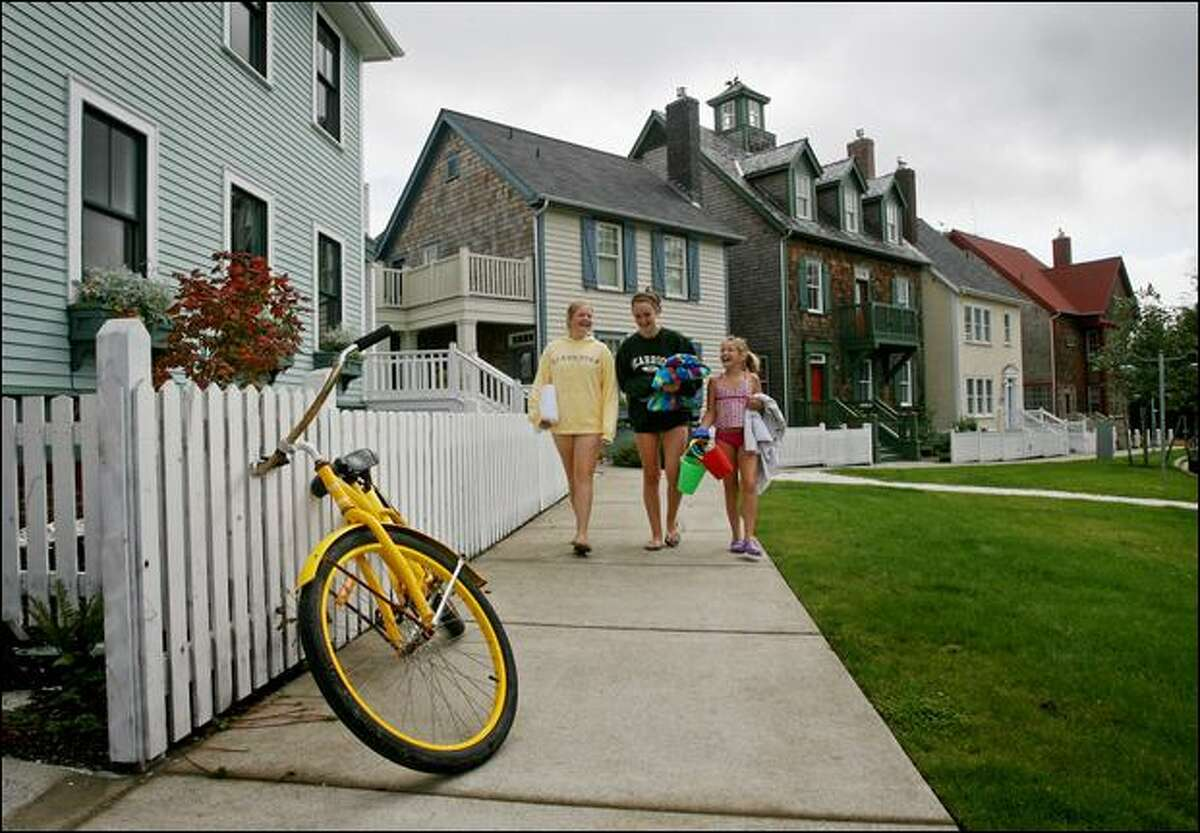 Kelsey Mendenhall, 13, Stefania Ghilarducci, 13, and Ivy Mendenhall, 11, of Seattle, head to the beach from the house their families rented at Seabrook. The vacation home project in Pacific Beach is built according to the tenets of New Urbanism, which emphasizes walkable designs unusual in resort communities.