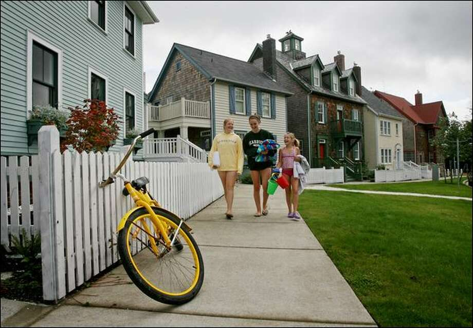 Kelsey Mendenhall, 13, Stefania Ghilarducci, 13, and Ivy Mendenhall, 11, of Seattle, head to the beach from the house their families rented at Seabrook. The vacation home project in Pacific Beach is built according to the tenets of New Urbanism, which emphasizes walkable designs unusual in resort communities. Photo: Dan DeLong/Seattle Post-Intelligencer