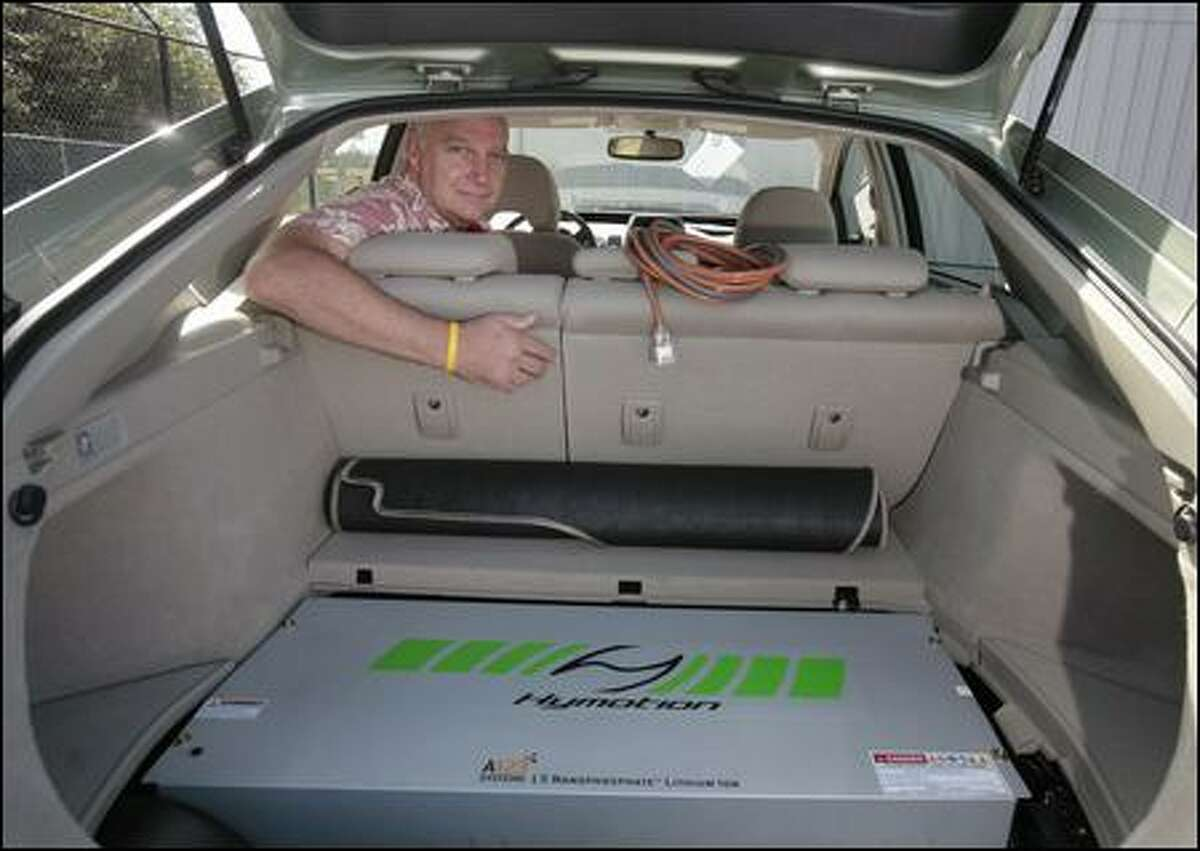 """Dan Davids of Woodinville had this lithium battery installed in his Toyota Prius. It is located where the spare tire would go. Davids and Hymotion, the company that makes the battery, said it doubles the miles per gallon from 50 to 100. """"I can go 1,000 miles on a regular (10-gallon) tank of gas,"""" Davids says."""