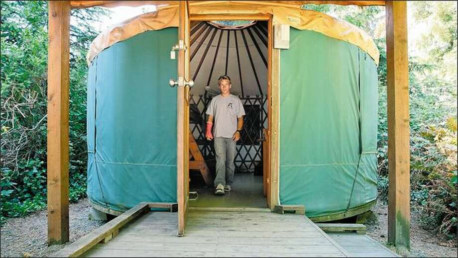 A c&er checks out a yurt at Harris Beach State Park near Brookings Ore. & Yurts prove to be a boon for campers at Oregon state parks ...