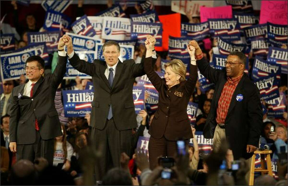 (l-r) Former Washington Governor Gary Locke, Rep. James Inslee , Presidential Democratic candidate Sen. Hillary Clinton and King County Executive Ron Sims during a visit to the Pacific Northwest before this weekend's caucus at Pier 30 in Seattle. The Senator appeared before a rowdy crowd of supporters downtown.